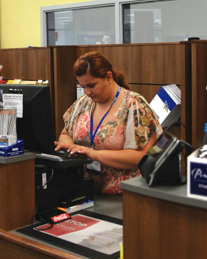 Senior+communications+major+Daniela+Miramontes+works+on+the+cash+register+at+the+CSUB+Bookstore+on+Sep.+9.+Photo+by+AJ+Alvarado