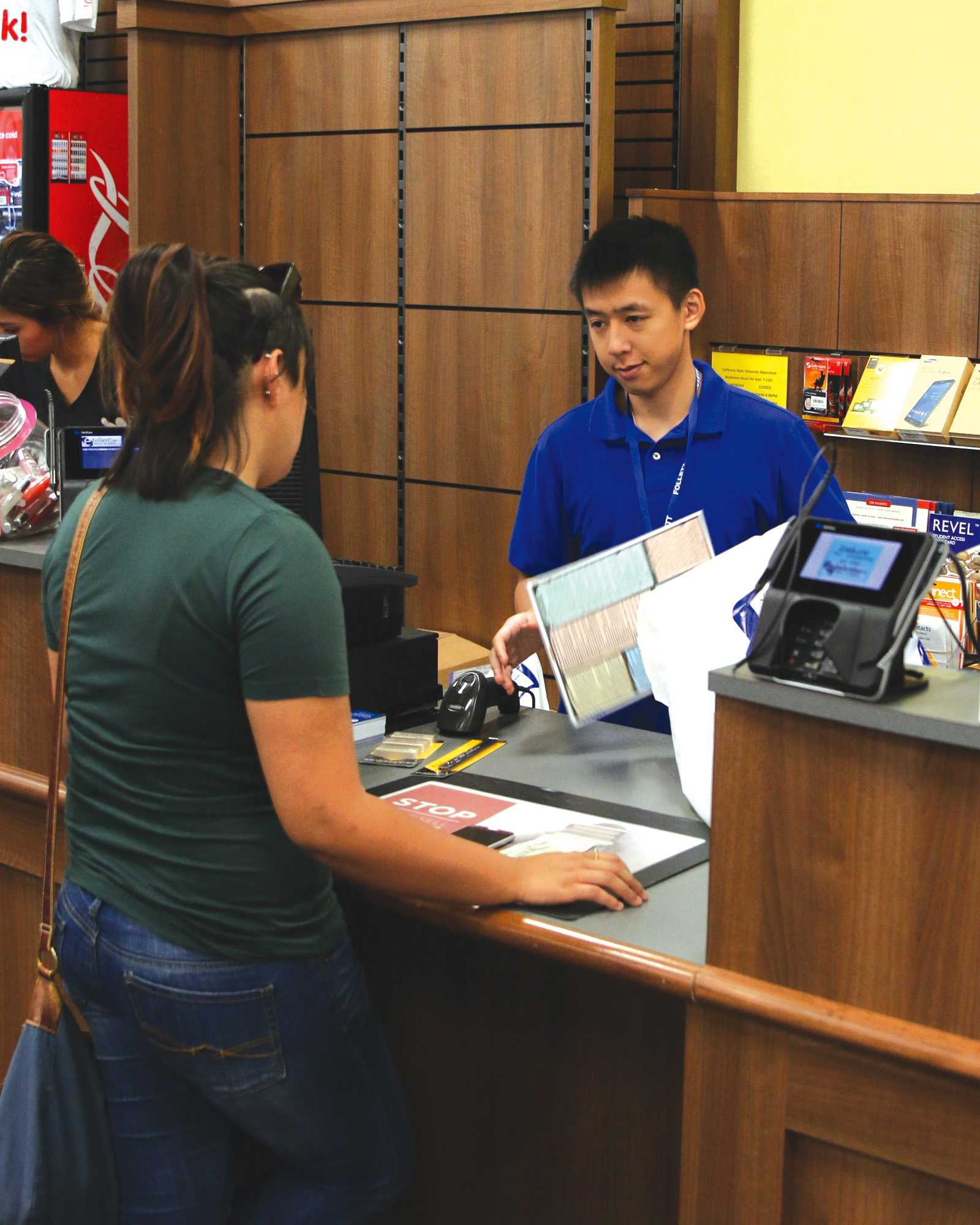 Sophomore nursing major Andrew Nguyen checks out a student at the CSU Bakersfield Bookstore on Sept. 9. The bookstore is inside the Student Union, which is one of the many building or centers that assist students. Photo by AJ Alvarado