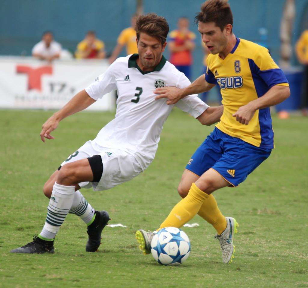 CSUB+senior+midfielder+Christian+Duarte+fights+to+keep+possession+against+Utah+Valley+sophomore+midfielder+Connor+Salmon+on+Oct.+18.