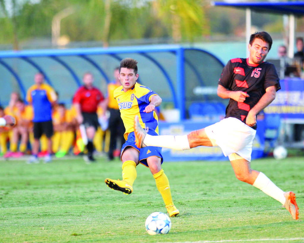 CSUB+senior+midfielder+Christian+Duarte+attempts+to+challenge+a+sliding+tackle+against+Ronnie+Bartenstein+of+the+University+of+the+Pacific+on+Oct.+4+at+the+Main+Soccer+Field.%0APhoto+by+AJ+Alvarado%2FThe+Runner