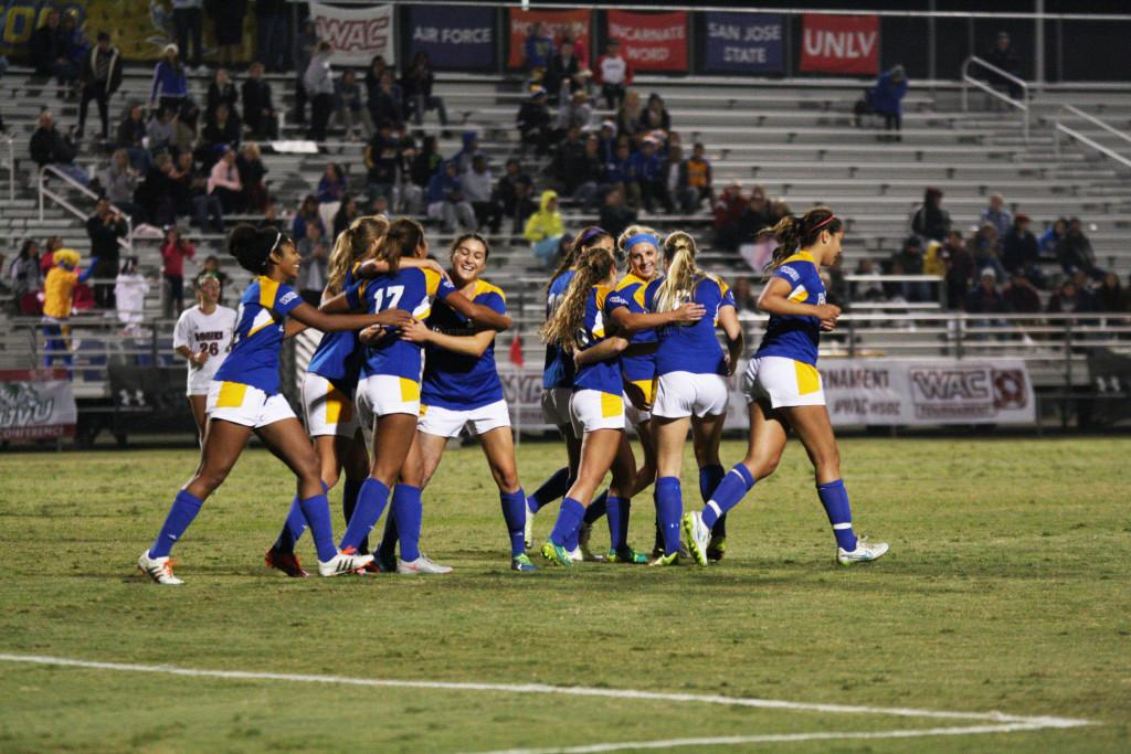 The+CSUB+women%27s+soccer+team+celebrates+after+redshirt-freshman+forward+Aminah+Settles+scores+a+goal+to+put+the+Roadrunners+up+2-0+in+the+second+half+against+the+Aggies+at+last+year%27s+Western+Athletic+Conference+Tournament.%0APhoto+by+Karina+Diaz%2FThe+Runner