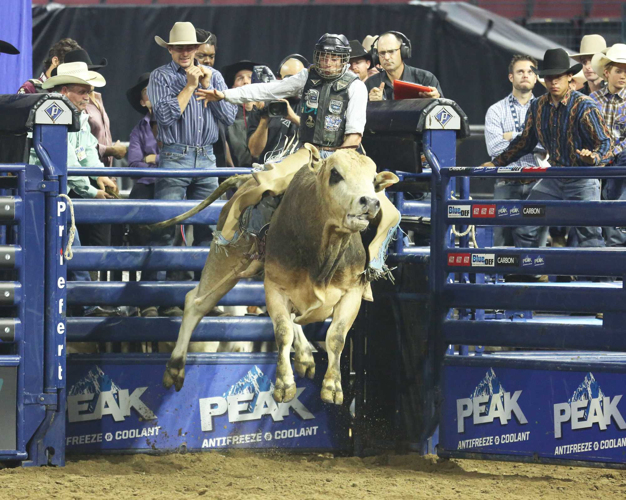 Scottie Knapp holds on tight as the roughly 1500 lb bull goes completely air-born in an attempt to throw the rider.