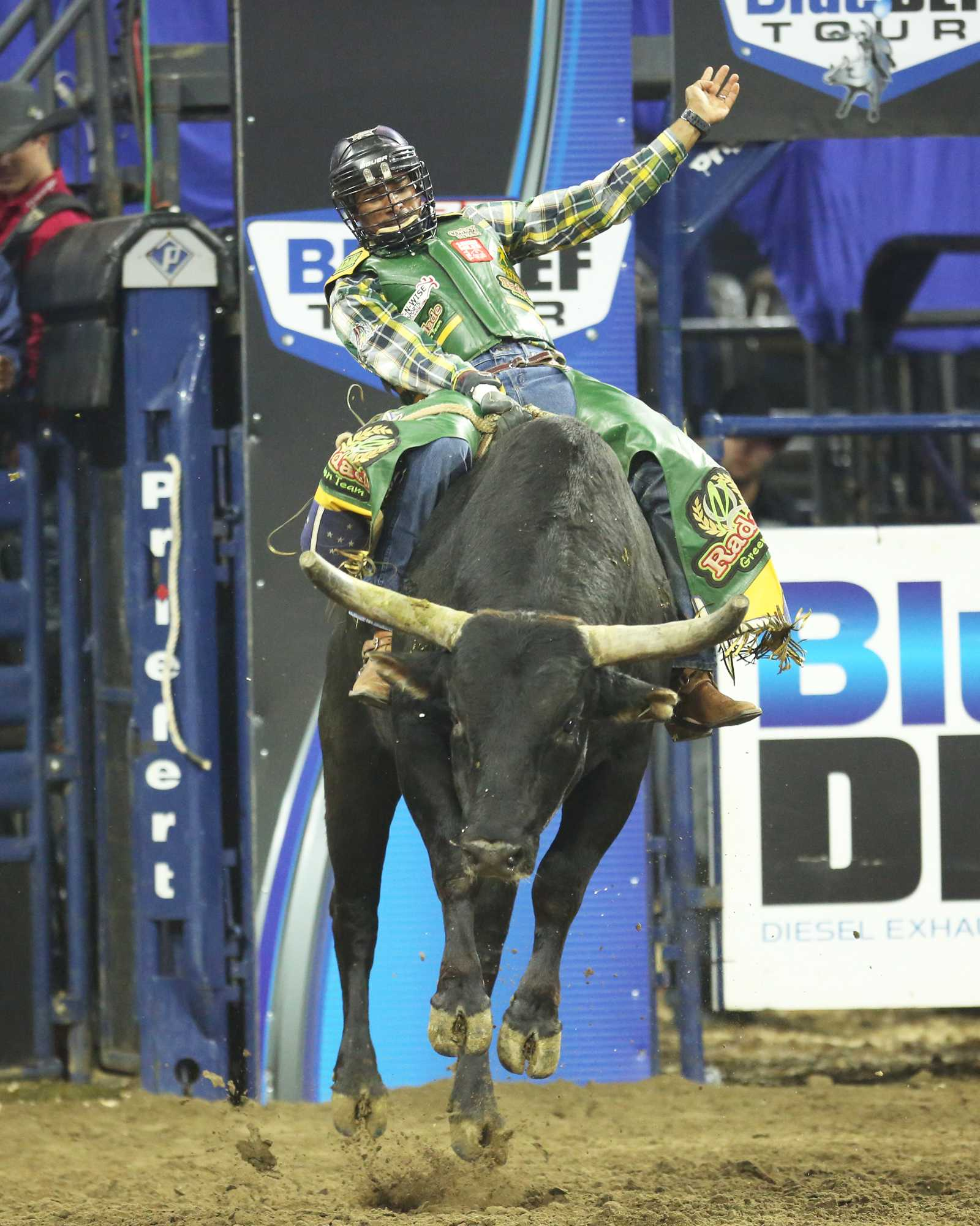 Douglas Lino de Souza tries to stay atop Choctaw during the event at Rabobank Arena on Saturday, Nov. 21.