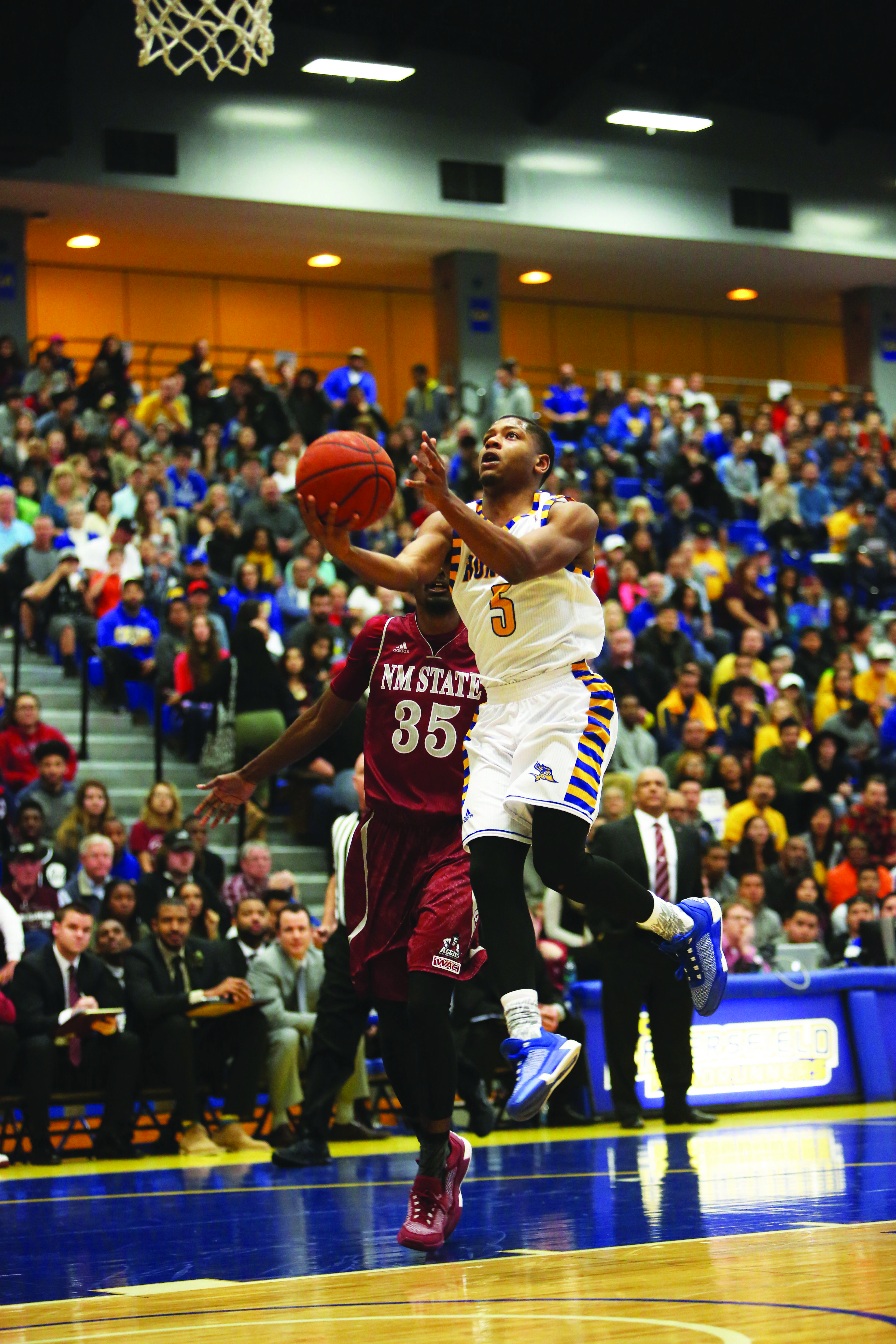 CSUB junior guard Dedrick Basile goes up for a layup against New Mexico State on Jan. 23 in the Icardo Center. Photo by AJ Alvarado/The Runner