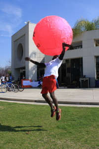 SRC Intramural Sports Coordinator Kareem Bland bounces the volleyball off his head at the National Rec Day on Monday.