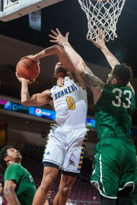 CSUB forward Matt Smith attempts to shoot over CSU's forward Jordan Madrid-Andrews on Thursday.  Photo by WAC Sports