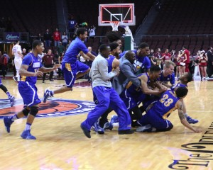 The CSUB men's basketball team piles on junior guard Dedrick Basile after he hit the game-winning three over New Mexico State on Saturday in the Orleans Arena. Photo by AJ Alvarado/The Runner