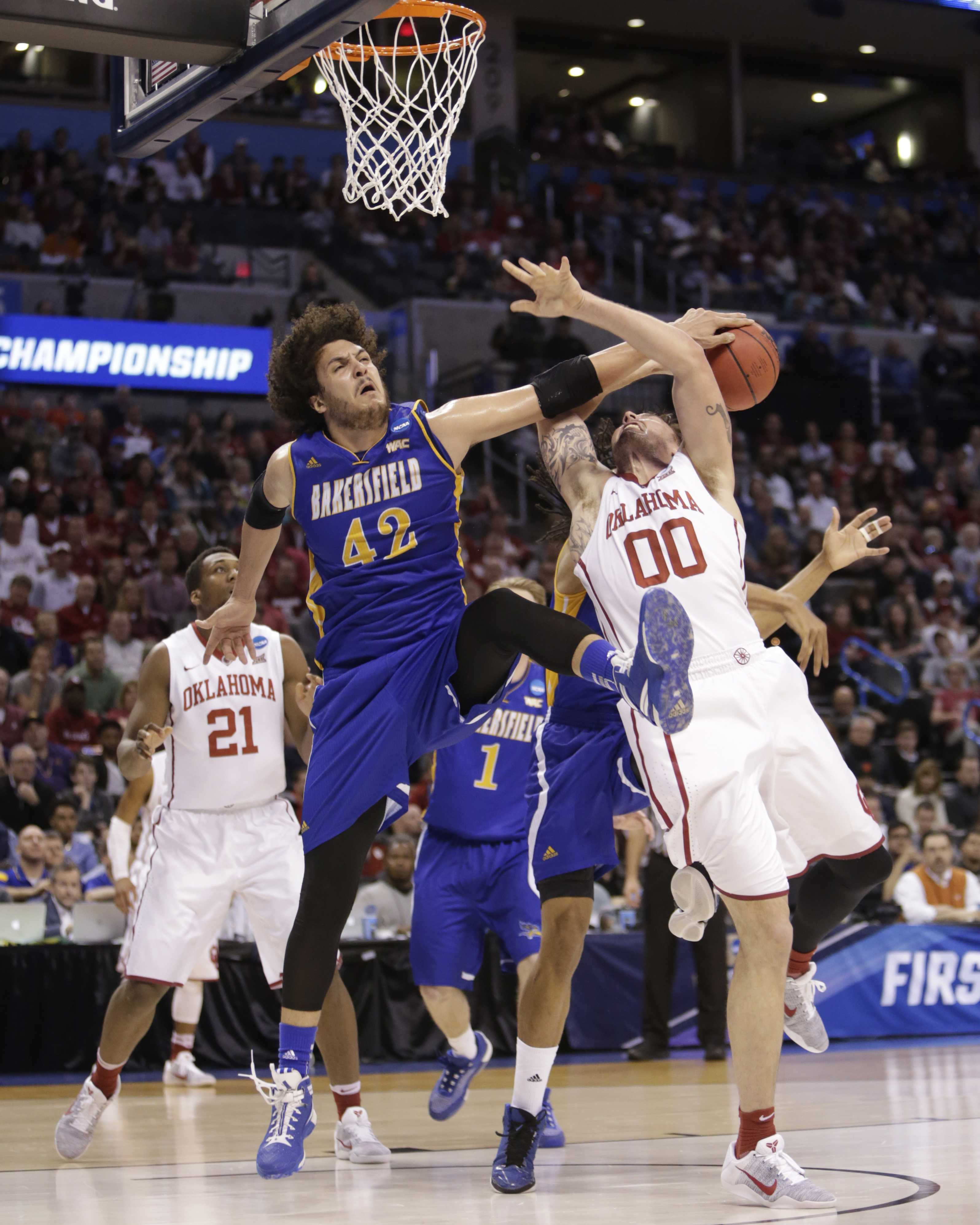 CSUB's Aly Ahmed blocks Oklahoma's Ryan Spangler shot during Friday's NCAA Division I Men's Basketball Tournament first round game. Photo by AJ Alvarado/The Runner