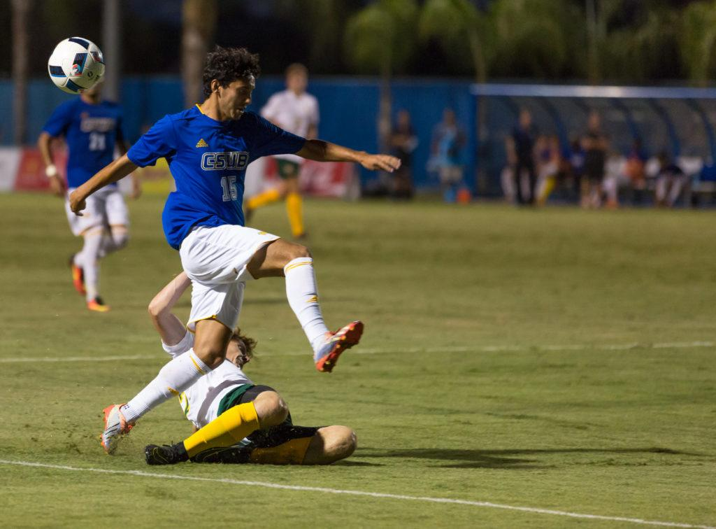CSUB%E2%80%99s+sophomore+midfielder+Jacob+Alatorre+attempts+to+avoid+the+University+of+San+Francisco%27s+Mitchell+McPartland+on+Thursday%2C+Sept.+1+at+the+Main+Soccer+Field.+%0APhoto+by+Ben+Patton%2FThe+Runner