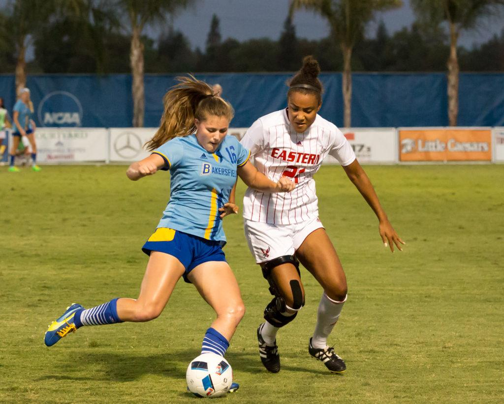 Darian+Gambetta+kicks+under+pressure+against+Eastern+Washington+University%E2%80%99s+Maia+Inniss+in+the+first+half+of+Friday%E2%80%99s+game+at+the+CSUB+main+soccer+field.%0ABen+Patton%2F+The+Runner%0A