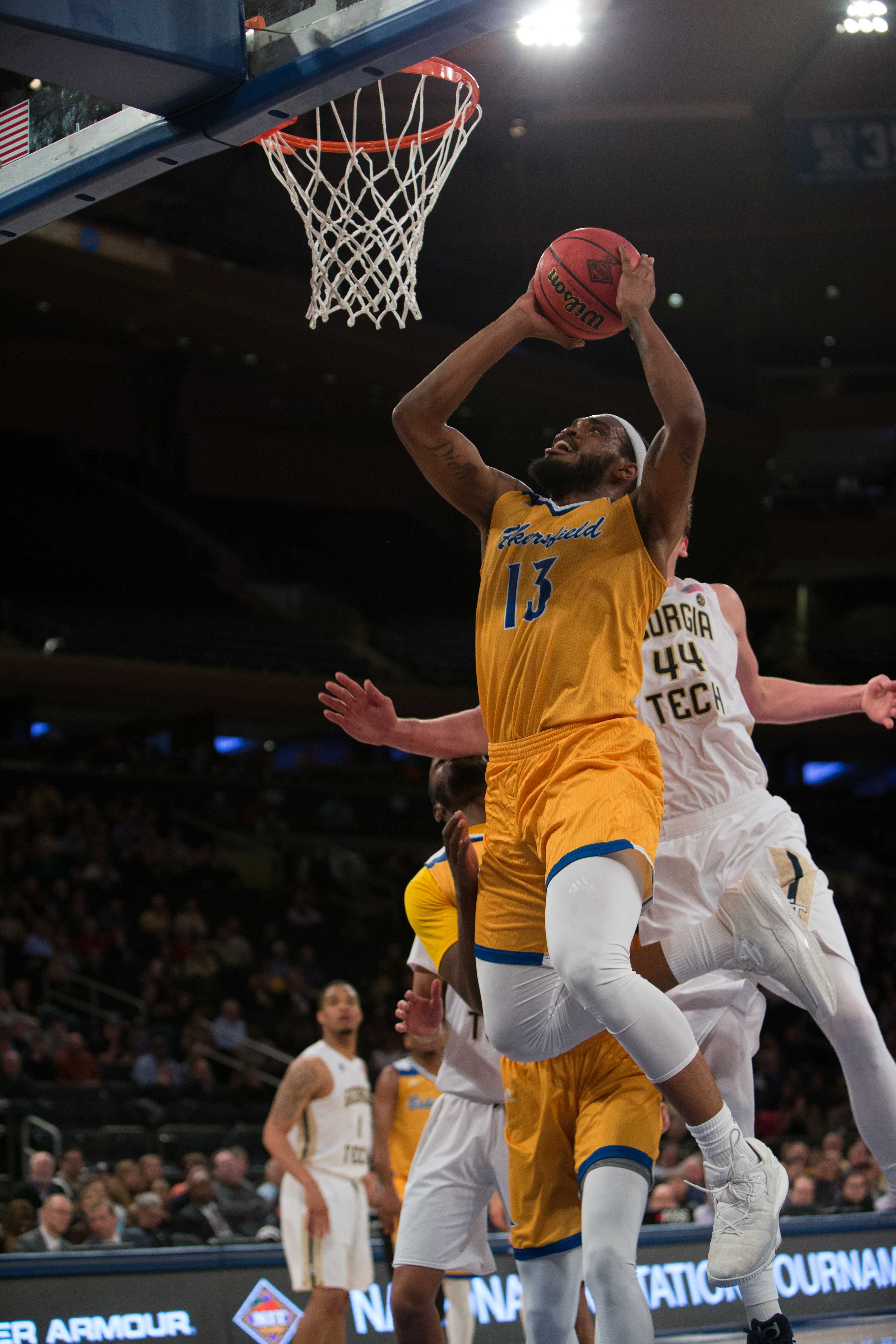 Junior swingman Shon Briggs goes up for a contested layup against Georgia Tech.  Photo by AJ Alvarado/The Runner