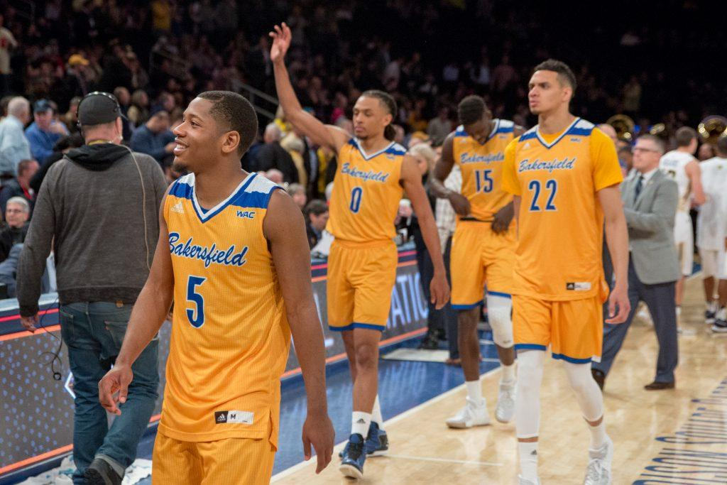 Dedrick+Basile+%28left%29%2C+Matt+Smith+%28center%29%2C+Moataz+Aly+%28right%29+acknowledge+the+CSUB+faithful+as+they+depart+from+Madison+Square+Garden+after+making+their+historic+tournament+run.+%0APhoto+by+AJ+Alvarado%2FThe+Runner