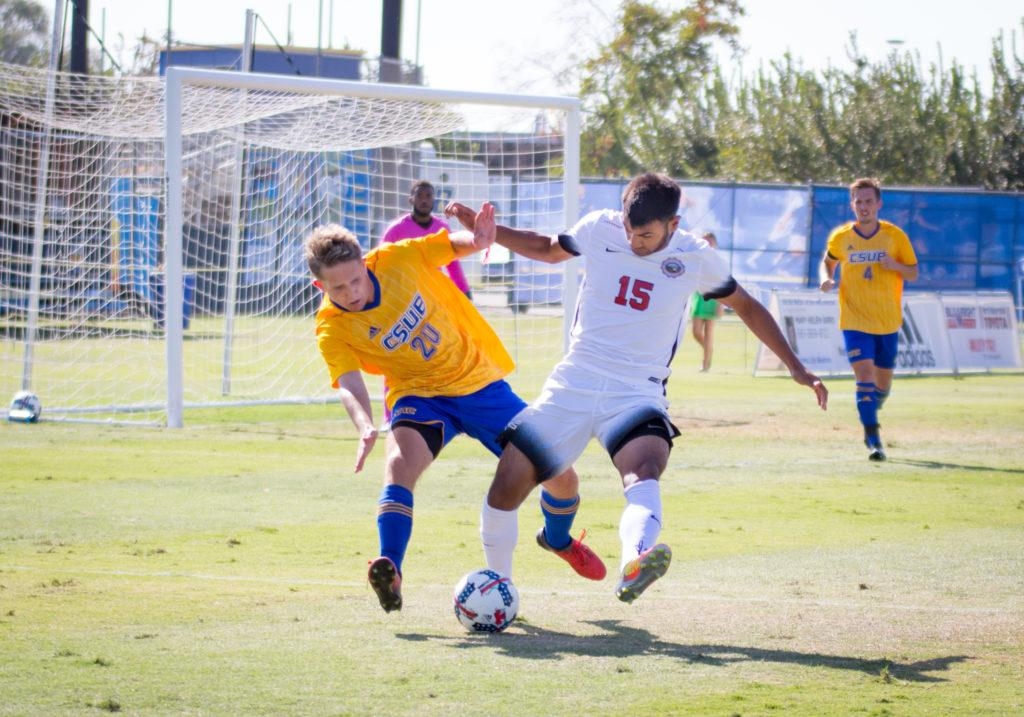 CSUB+freshman+defender+Tanner+Knorr+battles+for+possession+with+UNLV+junior+midfielder+Daniel+Moran+in+a+match+on+Sunday%2C+Oct.+8+at+the+Main+Soccer+Field.+The+Roadrunners+have+won+three+straight+games+in+conference+play.+%0APhoto+by+Simer+Khurana%2F+The+Runner+