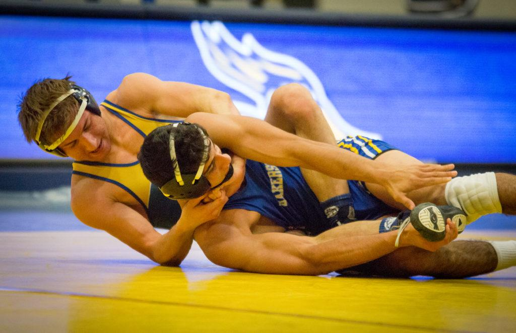 In+the+125-weight+class%2C+Alex+Hernandez-Figueroa%2C+a+redshirt-freshman+and+Sergio+Mendez%2C+a+redshirt-senior%2C+wrestle+in+the+Icardo+Center+during+the+Blue-Gold+Dual+on+Oct.+21%0APhoto+by+Simer+Khurana%2F+The+Runner