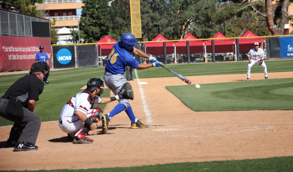 Freshman+Daniel+Carrizosa+makes+contact+during+CSUB%27s+loss+against+CSU+Northridge+on+Tuesday%2C+March+27+at+Matador+Field.