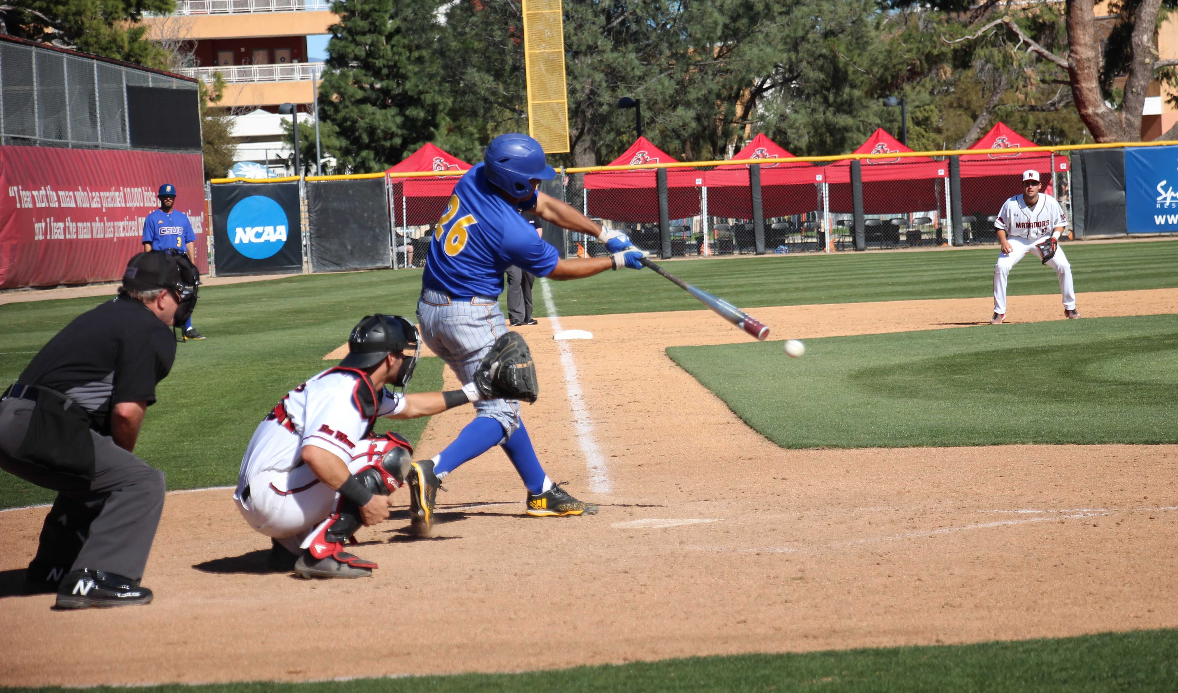 Freshman Daniel Carrizosa makes contact during CSUB's loss against CSU Northridge on Tuesday, March 27 at Matador Field.