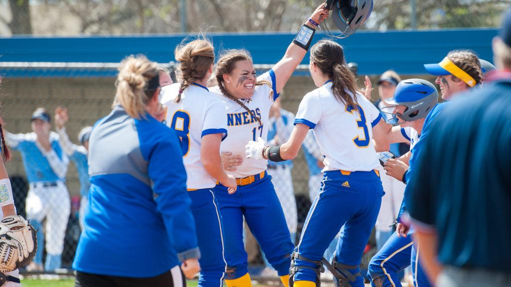 Paige+Johnson+%28center%29+celebrates+with+teammates+after+her+walk-off+base+hit+against+San+Diego+on+%0ASaturday%2C+March+17+at+the+Roadrunner+Softball+Complex.+They+won+2-1+in+8+innings+to+snap+their+8-game+losing+streak.%0A%0APhoto%3A+gorunners.com