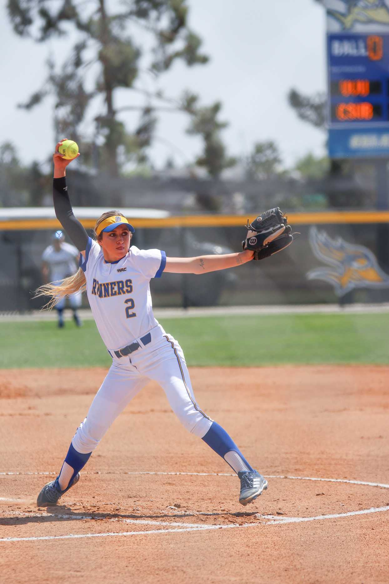 Senior Summer Evans winds up to pitch against Utah Valley  University at the Roadrunner Softball Complex on Friday, April 27.   Photo by Ana Canales/ The Runner