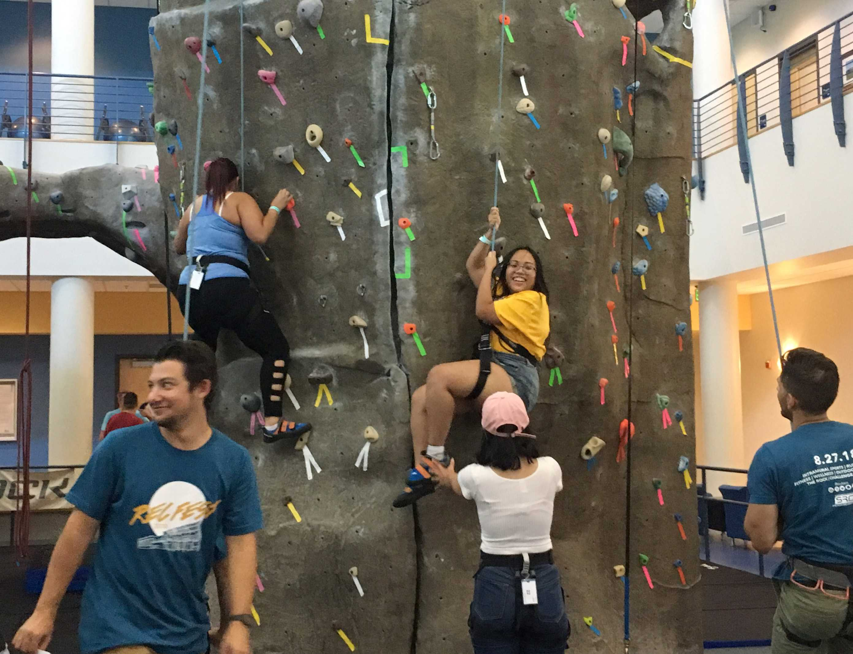 Students climb the rock wall in the Student Recreation Center during Rec Fest on Monday, August 27. Photo by Valerie Hernandez