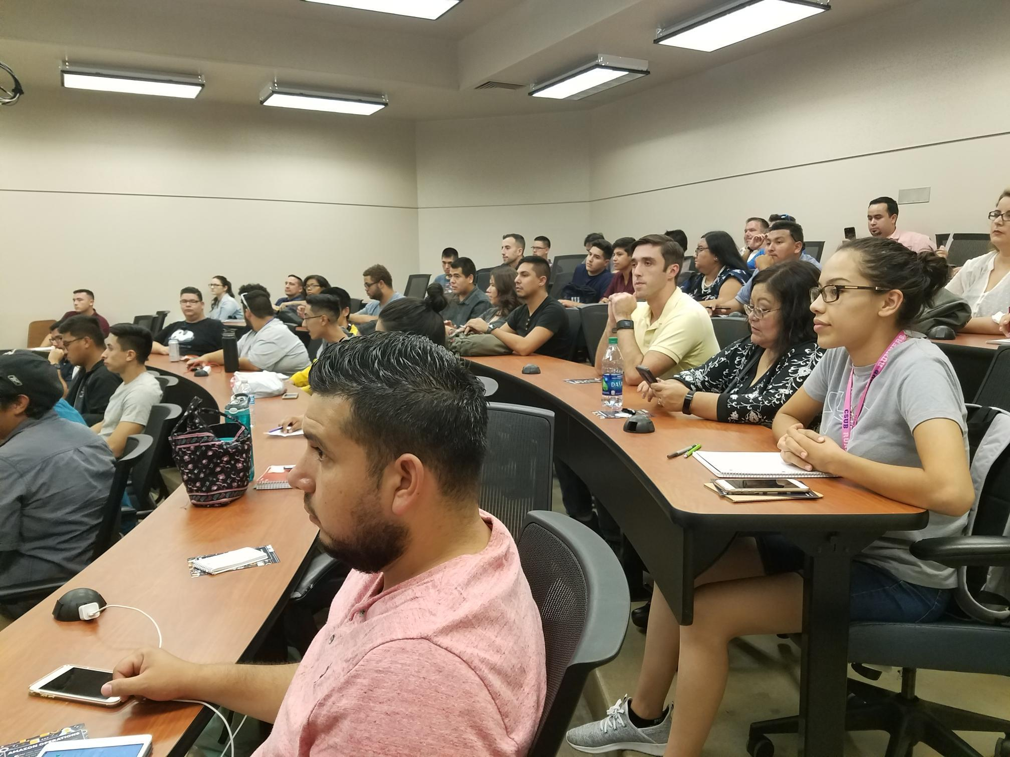 Amazon delivers job and internship information to a packed lecture hall