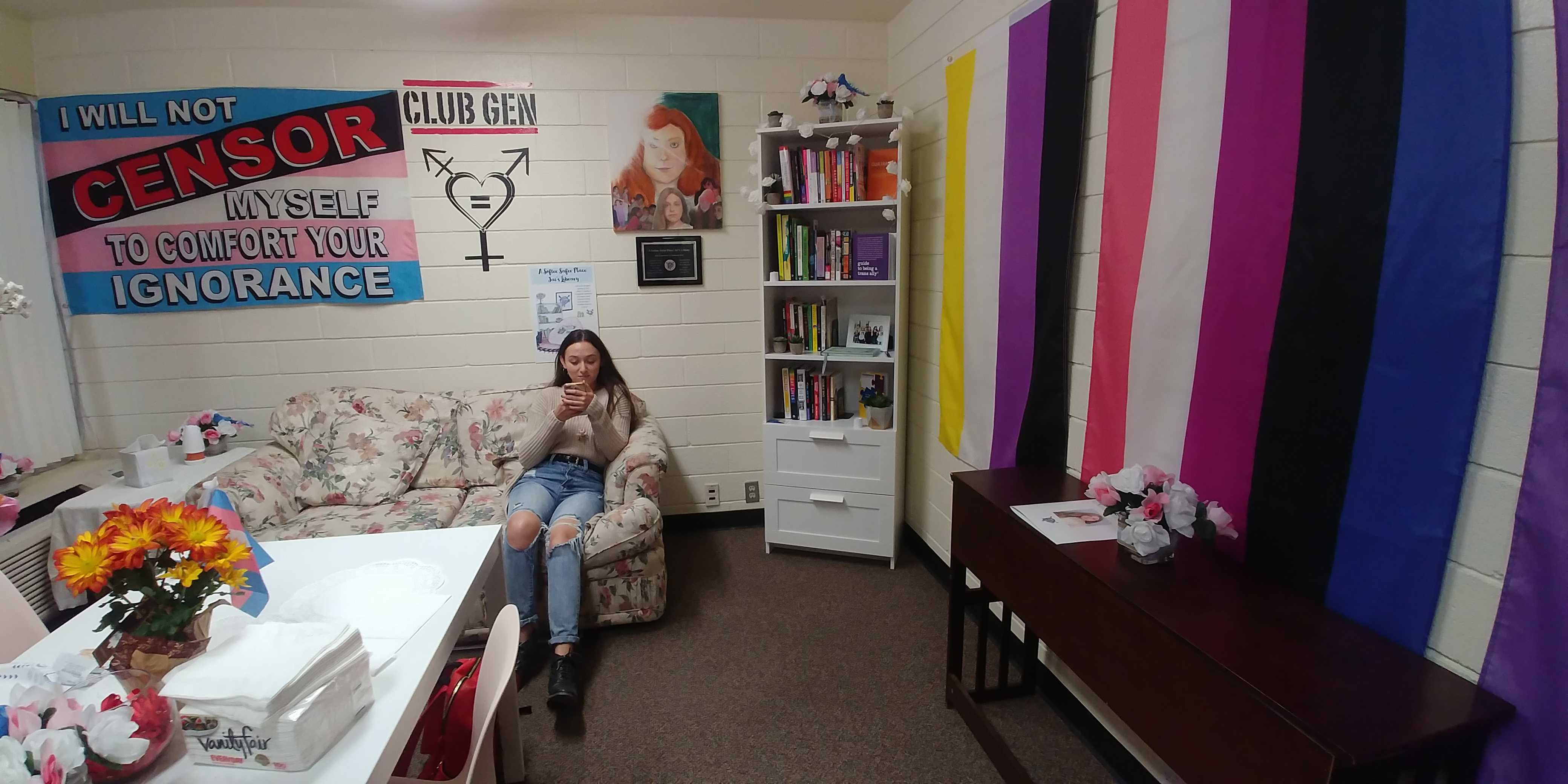Andrea Gray, a member of Club GEN, hangs out in the Club GEN's room where Jai's library is located.