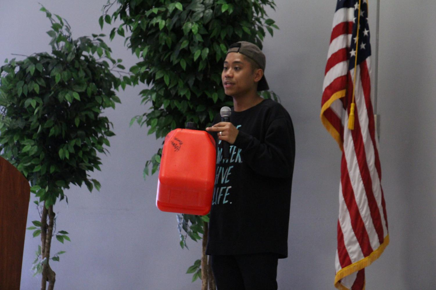 Roel Romualdo, former intern and member of the CSU Bakersfield Thirst Project Club, demonstrates how limiting it can be for communities to access clean water in the Student Union Multi-Purpose Room on March 21.  Leo Garcia/The Runner