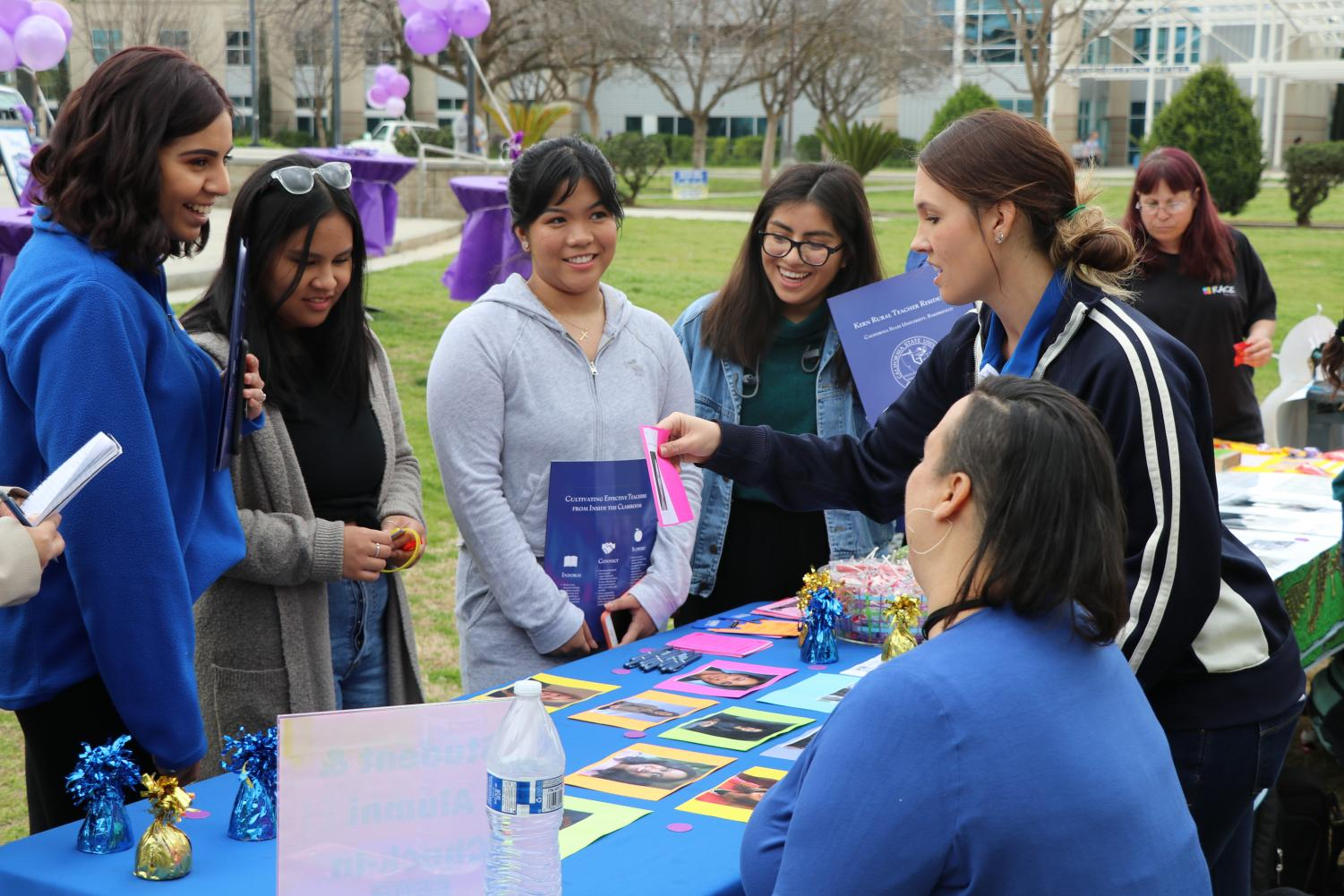 Students come together for the women's celebration kick off event at CSU Bakersfield's SU Patio on Monday, March 4.   Sergio Hernandez/The Runner