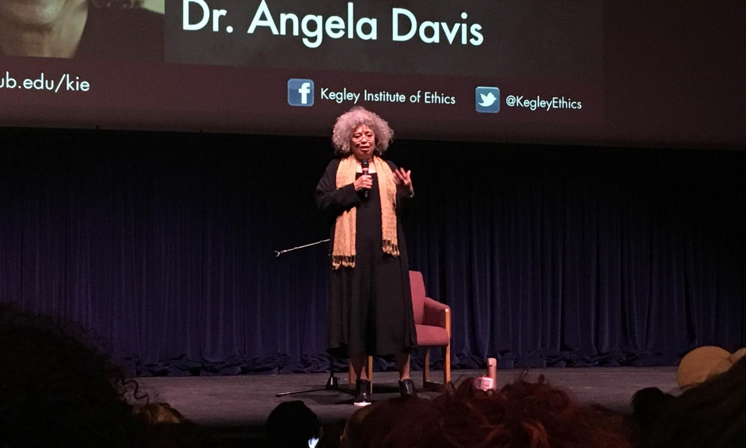 Angela Davis speaks inside the Dore Theatre on April 11.  Photo by Marsulh Mussad/ Special to The Runner
