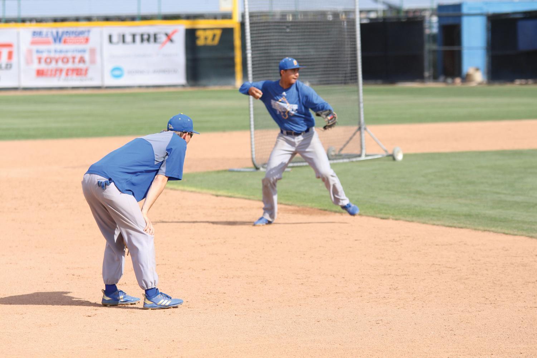 Junior infielder Tyler Jorgensen and senior Noah Barba practicing their infield defense on April 3, 2019.