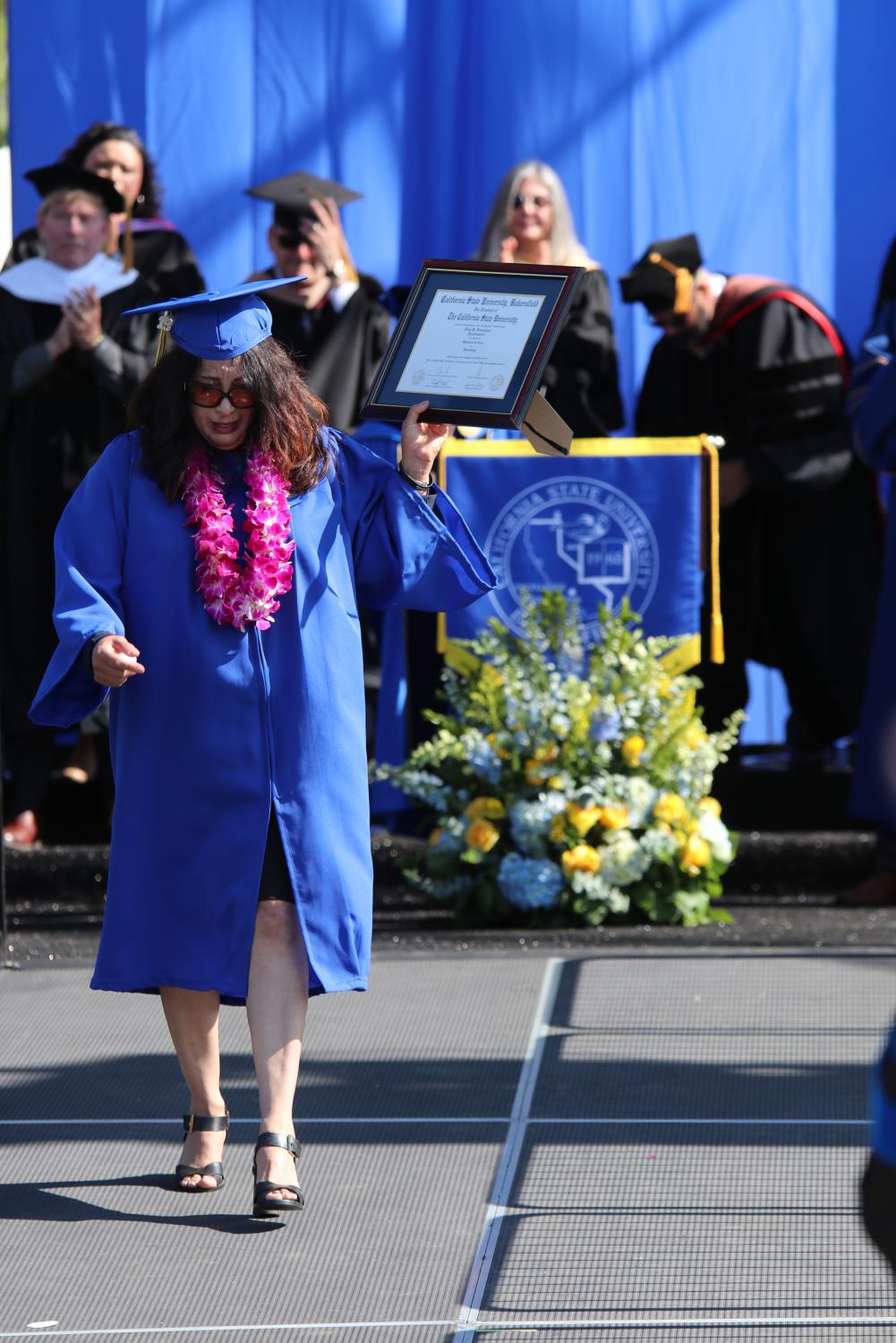 Photo by Sergio Hernandez: Tracy Dominguez accepted her late daughter Demi Dominguez's Posthumous Degree during the Undergraduate Ceremony on May 24, 2019.