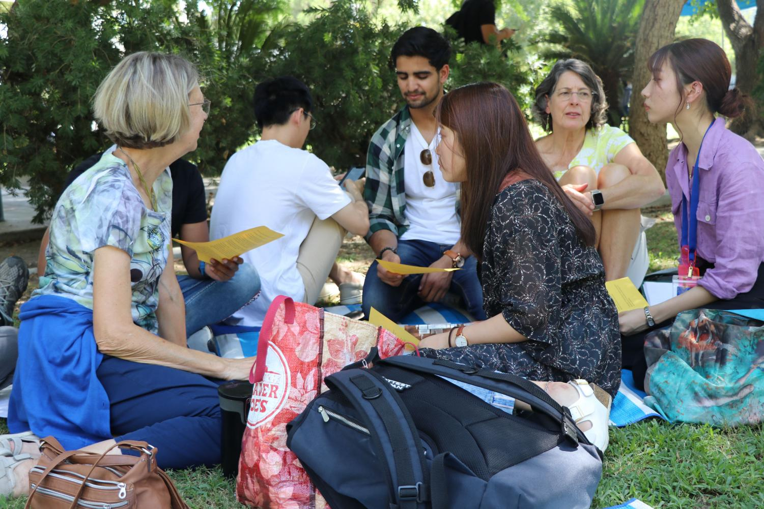 Event coordinators and International Students on campus gather around during talk time for fellowship on Sept. 3, 2019.