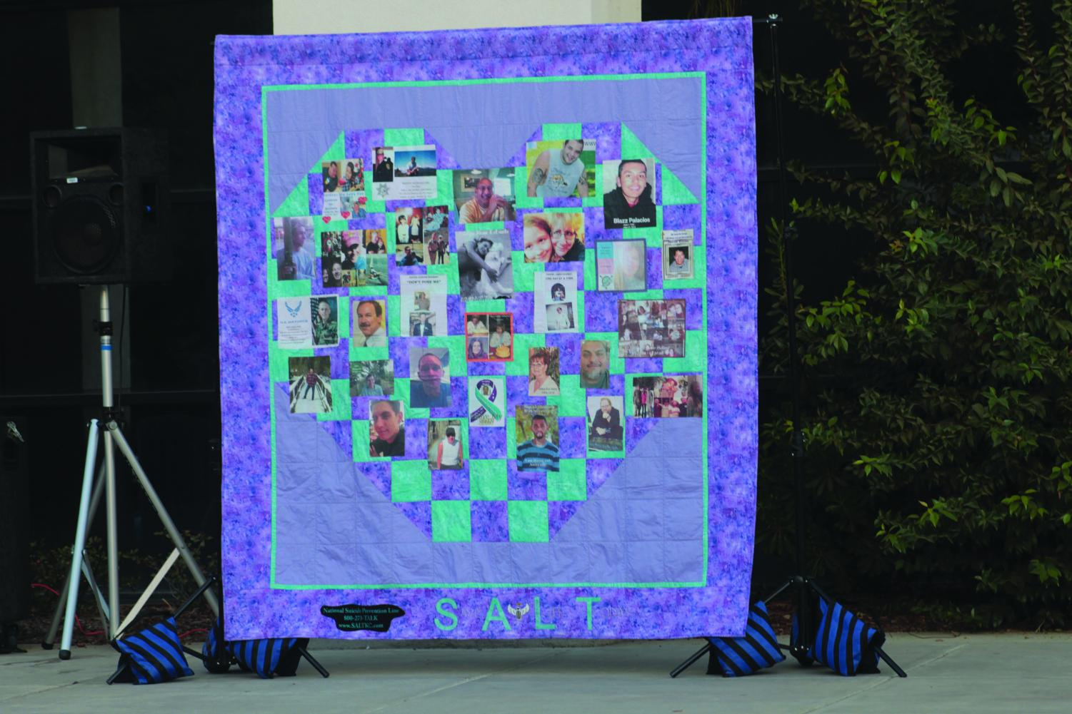A blanket from the organization S.A.L. T (Save a Life Today)commentating the lives of individuals on October 22, 2019 at the 6th Annual CSUB Candlelight Event.