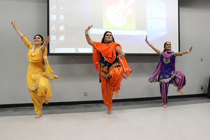 From+left%3A+Henna+Singh%2C+Yaddeep+Kaur+Gill%2C+and+Jasleen+Mander+%E2%80%AFpreform+a+Bhangra+dance%2C+a+Punjabi+folk+dance.+The+Bhangra+dance+is+done+at+every+occasion+of+happiness%2C+such+as+weddings%2C+birthdays%2C+and+festivals.+Henna%2C+Kaur%2C+and+Jasleen+are+all+wearing+Salwar+Kameez+suits.+