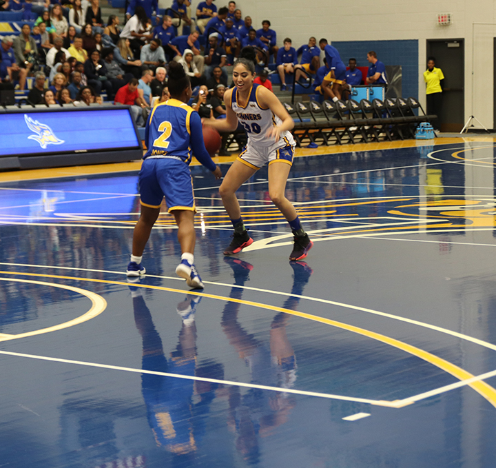 Junior+guard%2C+Kate+Tokuhara%2C+tries+to+dribble+the+basketball+around+Senior%2C+Dalis+Jones%2C+during+the+Blue+Gold+event+held+on+Tuesday+Oct.+22+2019+in+the+Icardo+Center.