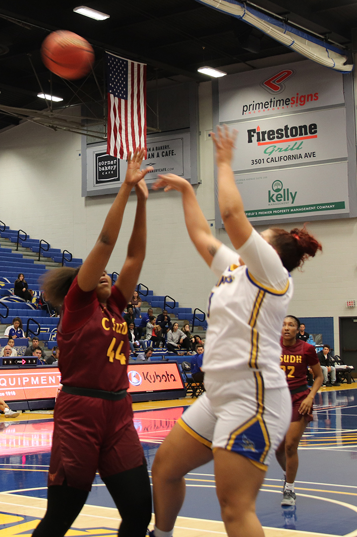 Sophomore Center Makenzie Bond goes for a two-point basket on Tuesday Nov. 5 at the Icardo Center during opening night.