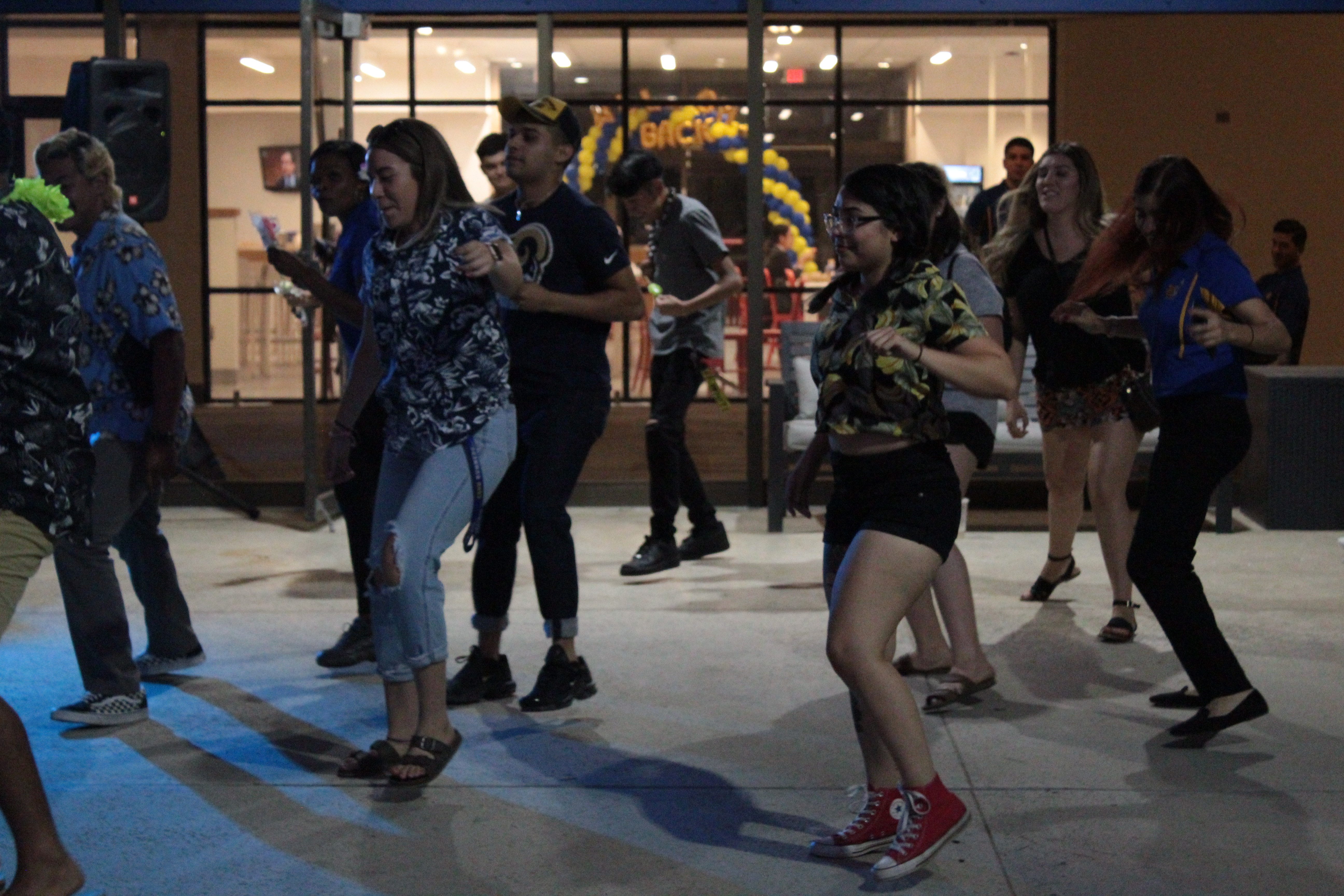 A+group+of+students+dance+during+the+last+hour+of+the+Runner+Luau+on+Tuesday%2C+Sept.+3.+